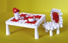 Table and chair with a cup and bouquet...for a doll house perhaps ~?~