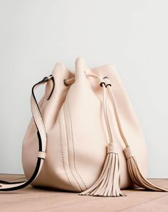 This purse is perfect for November because the off white color is perfect for…