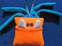Monster Tooth Pillow  Orange and Turquoise by fangdangles on Etsy, $19.50..... I bet I could make this!