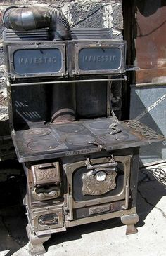 There's Beauty In The room: 15 Vintage Cook Stoves  Majestic Wood Burner Found on farmcollector.com