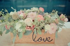 Perfect florals for a mint and pink wedding or party. wooden box arrangement