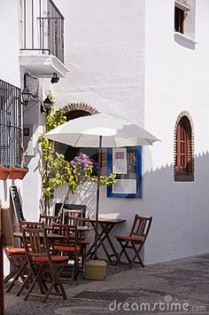 Terrace in narrow alley of an Andalusian village order up a bottle and relax - beautiful