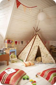 I played in the attic as a kid, so turning it into a playroom for kids really appeals to me.