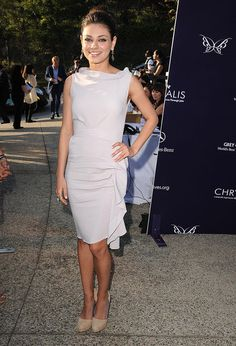Mila Kunis Style Profile: At the Butterfly Ball in June 2010, she went chic in a creamy, curve-hugging sheath.