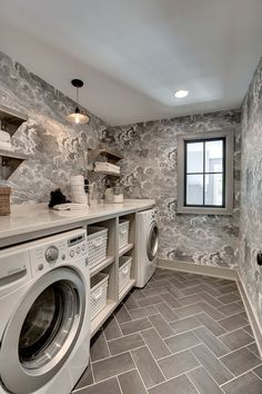 Small Laundry Room Ideas | Herringbone Tile Floors | Wallpaper Laundry Room | Front Loading Washer Dryer | Laundry Basket Built In | Laundry Room Open Shelving