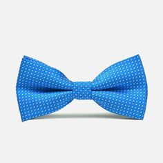 Blue Polka Dot Bow Tie: If your outfit is lacking a certain kick to it, it might be because you do not have this trim bowtie to liven things up a bit. The bright blue material of the bow tie is spotted with silverpoint polka dots, making it perfect for that loud finish. bowselectie.com