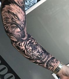 Full Sleeve Tattoos 92896 Roaring tiger tattoo with an eagle head decorated with a savannah landscape on forearm Tattoos Arm Mann, Forearm Sleeve Tattoos, Eagle Tattoos, Best Sleeve Tattoos, Full Sleeve Tattoos, Wolf Tattoos, Tattoo Sleeve Designs, Leg Tattoos, Tiger Forearm Tattoo