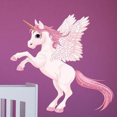 Vinilo decorativo infantil en tonos rosas con alas. Un llamativo diseño para decorar un dormitorio infantil.