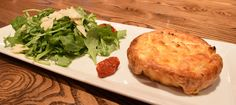 Giacomo's Sweet Italian Sausage, Cauliflower and Goat Cheese Quiche with arugula salad | Green Valley Grill | Greensboro, NC