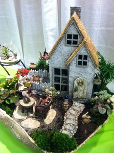 Wow, this little fairy garden has everything, even a little glass gazing ball and a little table.