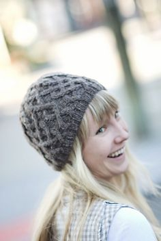 A warm, handknit hat perfect for both newbie and seasoned cablers alike. Crown shaping is integrated into Aran patterning to create a root-like star motif at the top of the head.