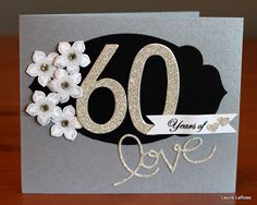My Mom and Dad got married 60 years ago, today! They are a shining example of true love through a lifetime!  Stampin'Up! Dazzling Diamonds Glimmer paper seemed a good starting point for the diecut numbers and Expressions Thinlit. Stamped Petite Petals in Smoky Slate and used the coordinating punch.