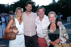 Actress and Gerard Philipe daughter's, Anne-Marie Philipe (R), her husband Jerome Garcin, their son and his companion attend the 30th Ramatuelle Festival : Day 3 on August 3, 2014 in Ramatuelle, France.