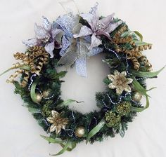 Silver and Gold Christmas Wreath, Gold spiral wreath, Taupe poinsettia wreath, Evergreen wreath, Hol Holiday Wreaths, Holiday Crafts, Holiday Decor, Holiday Ideas, Poinsettia Wreath, Gold Christmas, Gold Flowers, Party Gifts, Decorative Items