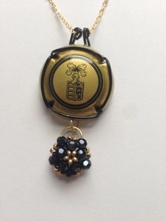 Gold and Black Champagne Cap Pendant Necklace with by IsAdorned