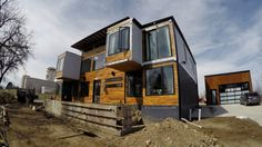 A metro Denver house built out of nine steel shipping containers is a home for Regan and Libby Foster.