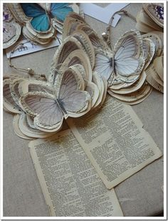Print and cut out butterfly images on old vintage book pages or sheet music found at thrift then trace around the image and make larger on each layer...stick with needle and tread to connect the layers...this would be great with other images too!