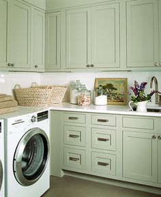 laundry room- painted cabinets. I need to get the nerve to just paint ours. It would really brighten up my laundry room.