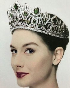 A lucky model wearing the emerald tiara formerly belonging to Empress Marie Louise of France, before it was bought by Van Cleef and Arpels, who replaced the fabulous emeralds with turquoise