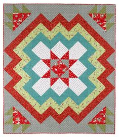 Two shapes are all it takes. This dynamic quilt is composed entirely of  squares and triangle-squares in various color combinations.
