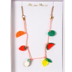 A bright and beautiful charm necklace with colorful fruit charms crafted in translucent acrylic and suspended on a neon coral cord with gold link chain and clasps. Pack contains 1 necklace.Pack size: 4 x 6 inches. Girls Accessories, Jewelry Accessories, Tassel Necklace, Pendant Necklace, Necklace Charm, Charm Jewelry, Jewelry Necklaces, Neon Jewelry