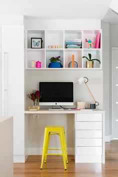 Cubbies and brights. A simple built-in desk with a row of drawers and overhead cubby-like shelves provide plenty of storage for important papers and supplies while maintaining a sleek profile. A lemon yellow stool plus neon accessories in the cubbies make for a cheerful, modern look. A setup like this would work well in a kitchen, living room or hallway.