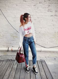 NEW YORK OUTFITS - LE HAPPY : LE HAPPY. White graphic cropped sweatshirt+mom jeans+black sneakers+dark red handbag+gold chokers. Spring Casual Outfit 2017