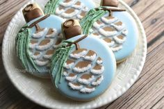 Christmas cookies.  I love the texture on the pine, the technique for the snowy pinecone, and that the design is on an ornament cookie shape.