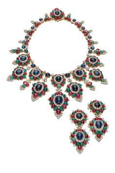 Gold necklace and pendant earrings with sapphires, emeralds, rubies, and diamonds. (1967)    - ELLE.com