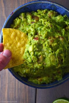 This fresh and authentic ultimate guacamole recipe has a subtle spicy kick and a profound lime flavor that makes it unique. Our favorite authentic guacamole recipe made with a subtle spicy kick and a profound lime twist. Authentic Guacamole Recipe, Best Guacamole Recipe, Guacamole Dip, Avocado Dip, Homemade Guacamole, Mexican Food Recipes, Vegan Recipes, Cooking Recipes, Appetizer Dips