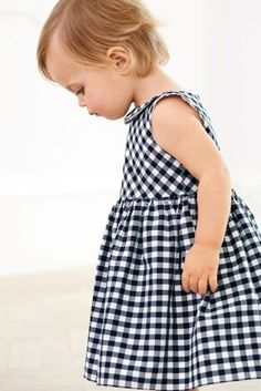 Smart and stylish from the very start! This Navy Gingham Dress is perfect for your cheeky monkey and this seasons parties!