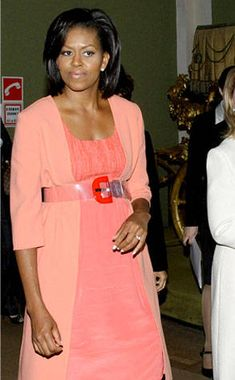 <p>To meet the First Lady of France, Mrs. Obama wears a long floral coat over a fuchsia dress by Thakoon, a designer she seems to be inclined to.</p>