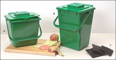 Compost buckets that can be hooked on the the inside of a cupboard door.  Perfect for dogs that like to eat compost (I'm looking at you Chevy!). :)