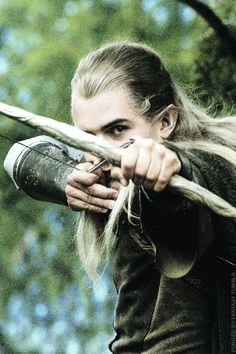 Orlando bloom looking really cool again as Legolas. He has very stylish bow form.