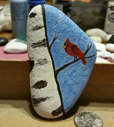 Cardinal on a limb rock