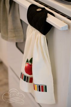 """combine a pot holder with a dish towel to get a """"stay-put"""" towel within reach when you need it"""