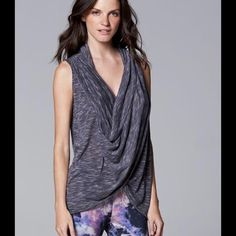 MAKE OFFER Simply Vera Sleeveless Wrap Top Stylish, lightweight, NWT. Scoop neck and wraps across mid section. Size is XS, but runs big and can easily fit small or medium. 90% rayon, 10% polyester. Simply Vera Vera Wang Tops