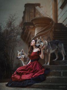 Wolf with wild woman in victorian red dress.... Mystic and fairytale photography - photo: Marketa Novak  model: Erika Bartošová