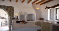 Paros, Greece. Traditional built hood, cupboards and counter covered by cement mortar.