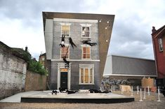 Experimental Public Spaces - Creatives are helping us explore the outside world with new multisensory experiences that augment nature and public spaces. Artist Leandro Erlich has created an illusionary house in Dalston, East London.