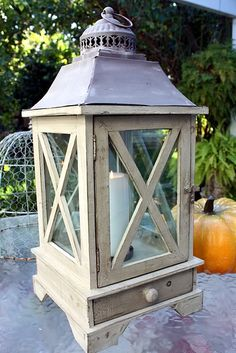 Created of reclaimed wood, zinc and glass, our Chateau Garden Windowpane Lantern with Matches Drawer will bring the glow and warmth of candlelight to your home and garden. Distressed to look old like the antique original this was copied after, the front opens to insert a pillar candle. Color is a soft French Greyish~green {I admit, it's a difficult to describe color}, match drawer on the bottom, so handy! We love these for outside, but also on the table for a romantic table setting. Wipe…