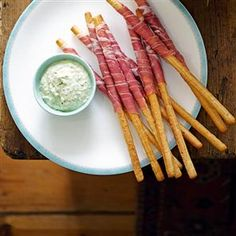Parma ham-wrapped grissini with pesto dip / Image via: Delicious Magazine  #spain #recipe