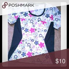 Gray and Pink Floral Scrub Top This top is floral with gray on the sides, which has a slimming effect. Also has a kangaroo pocket. Cherokee Tops