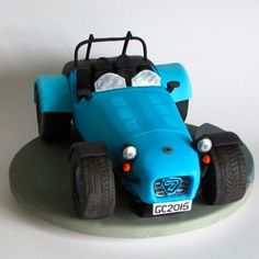 Caterham 7 birthday cake for Gordon - ginger cake filled and coated with chocolate ganache and fondant iced with handmade and painted details
