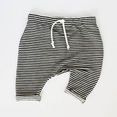 Sand in your toes, gentle beach breeze and a cold watermelon. These black and white baby harem shorts give the ultimate summer vibes. These shorts are on the must pack list for your next family vacay or comfy enough for every day wear. ★★Receive an instant 10% coupon upon sign up for my email newsletter http://eepurl.com/cg9oYj★★ FEATURES ✘ Handmade ✘ Made from a soft jersey blend ✘ Black and white striped baby harem shorts SIZING + MEASUREMENTS (waist measurements are approx...