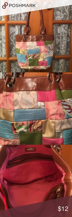 """Rosetti Patchwork Purse Like New Condition 14"""" x 12"""". Handle is 11"""". You can carry it on your shoulder. It has 3 nice size compartments. 1 inside side zipper and 2 slip in pouches on the other. The middle is s compartment that zips. The bag snaps closed. I have kept this in my drawer and hardly carried it. It lo is new. Non smoking home Rosetti Bags"""