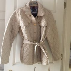 Lands' End quilted jacket This khaki colored quilted jacket is great for spring. Features two interior pockets. Missing button will be sewn back on. Lands End large is women's 14-16. I usually wear a 12 so plenty of room if you want to layer. Lands' End Jackets & Coats Trench Coats