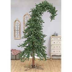 Weight - 24.00 lbs. Height - 120.00 in. Width - 29.00 in. Length - 29.00 in. The artifical Alpine Tree has full, natural looking foliage, a solid wood trunk, and a metal base. All trees come unassembled and are easy to put together and take apart for storage. The top portion of the bendable tree can be bent to an angle. Factory-suggested hanging weight is 2½ lbs. on the top bended tips and 1½ lbs. on the tree branches. Measures 10 feet high. NOTE: This is a large, heavy item. Please be aware… Alpine Christmas Tree, Alpine Tree, Grinch Christmas Decorations, Grinch Christmas Party, Christmas Time, Christmas Crafts, Holiday Decor, Christmas Ideas, Christmas Trimmings