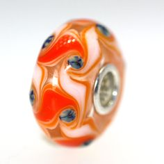 Sale on all Unique beads.  Trollbeads Gallery - Classic Unique 7957, $31.00 (http://www.trollbeadsgallery.com/classic-unique-7957/)