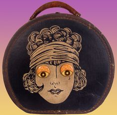 Extraordinary 1920s Flapper Novelty Handbag / Hat Box / Train Case that I wish I had bought. Beyond cool.